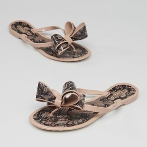 Dizzy Lace Print Jelly Bow Sandals